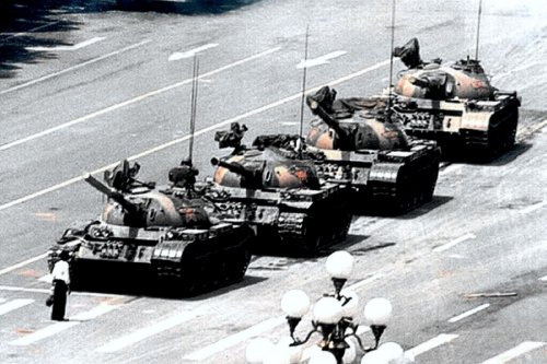 "The iconic image of ""Tank Man"" facing down the Chinese army during the Tiananmen Square uprising of 1989."